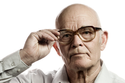 Elderly man with massive glasses isolated on white background